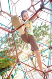 Young girl climbing giant web Stock Photography