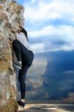 Young girl climbing on a limestone wall Stock Photos