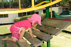 Young girl climbing on playground Stock Photo