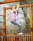 Young girl climbing rope in playground Royalty Free Stock Photography