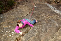 Young girl is climbing up Stock Image