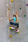 Young girl climbing a wall Royalty Free Stock Photography