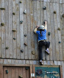 Young Girl Climbing Wall Stock Images