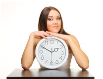 Young girl with clocks Stock Images