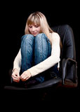 Young girl with closed eyes on chair Royalty Free Stock Photo