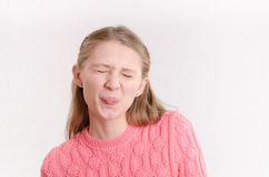 Young girl closed her eyes and pulled language Royalty Free Stock Photo