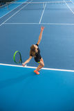 The young girl in a closed tennis court with ball Royalty Free Stock Images