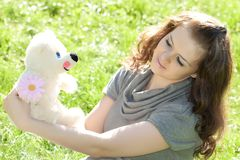 Young girl closeup portret with toy Royalty Free Stock Images