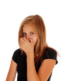 Young girl closing her nose with hand. A pretty blond slim girl closing her nose with her hand, das not like the smell, isolated for white background stock photography