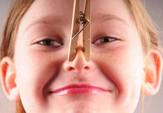 Young girl and clothespin Royalty Free Stock Photography