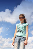 young girl clouds Stock Photography