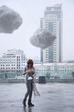 Young girl with clouds in her hands. Stock Photos