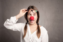 Young girl with a clown nose Royalty Free Stock Image