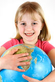 Young girl clutching a globe Royalty Free Stock Photography
