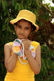 Young girl clutching purse Royalty Free Stock Images