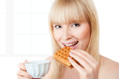 Young girl with coffee and pastry Royalty Free Stock Photo