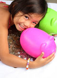 Young girl with coins and piggy bank Stock Photography