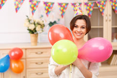 Young girl with colorful balloons Royalty Free Stock Images