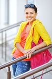 Young girl in colorful clothes with bag Stock Images