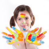 Young girl with colorful hands Stock Photos