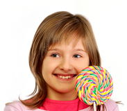 Young girl with colorful lollipop Stock Images