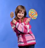Young girl with colorful lollipop Royalty Free Stock Image