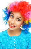 Young girl with colorful party wig Royalty Free Stock Image