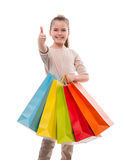 Young girl with colorful shopping bags Stock Images