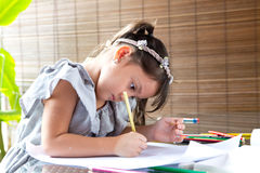 Young girl coloring Royalty Free Stock Photos