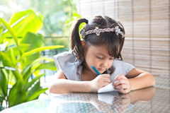 Young girl coloring Stock Photo
