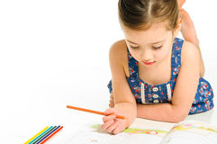 Young Girl Coloring a Picture Stock Photos