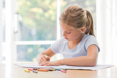 Young girl coloring picture Royalty Free Stock Photo