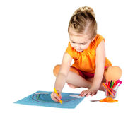 A young girl coloring a rainbow isolated Royalty Free Stock Photo