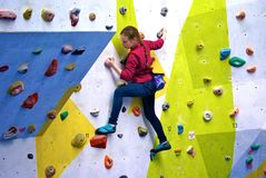 Young girl on a colourful climbing wall Royalty Free Stock Image