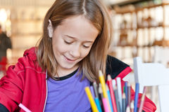 Young girl colouring Stock Photo