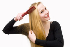 Young girl combs hair Stock Photography