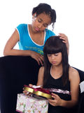 Young girl comforting girl wit. Young cute girl comforting her friend with a heartache Royalty Free Stock Photo