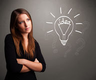 Young girl comming up with a light bubl idea sign Royalty Free Stock Photography