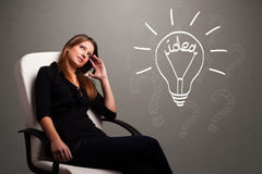 Young girl comming up with a light bubl idea sign Stock Image