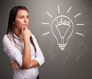 Young girl comming up with a light bubl idea sign Stock Photo