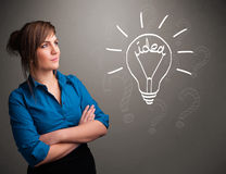 Young girl comming up with a light bubl idea sign Stock Images