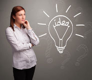 Young girl comming up with a light bubl idea sign Royalty Free Stock Photo