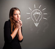 Young girl comming up with a light bubl idea sign Royalty Free Stock Photos