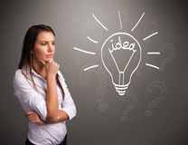 Young girl comming up with a light bubl idea sign Stock Photography