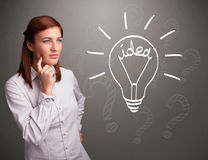 Young girl comming up with a light bubl idea sign Stock Photos