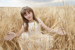 Young girl in communion dress Stock Image