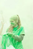 Young girl compleatly covered with green color powder Royalty Free Stock Photo
