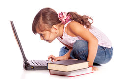 Young girl with computer Royalty Free Stock Photos