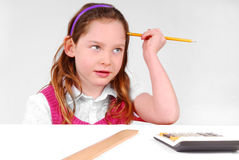 Young girl concentrating Royalty Free Stock Photography