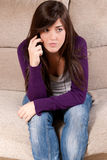 Young girl concerned talking by telephone bad Stock Image